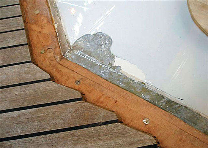 Margins boards have been routered away to allow teak removal and replacement. (figure 1)