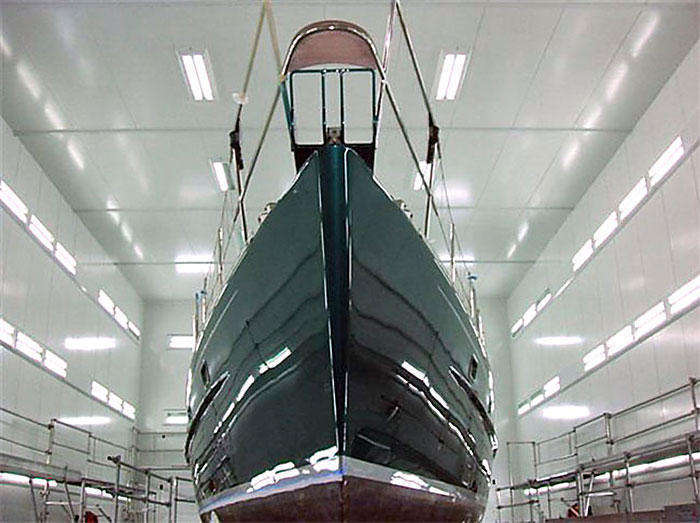 A dramatic view of the finish painted boat and our glossing booth (figure 5)