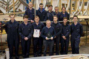 Keith Longman, Yard Manager, with some of the Berthon apprentices and the award