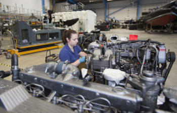 Engineering apprentice working on a vessel under an In-service support contract