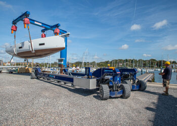 Motorboat being lifted off one of Berthon's boat movers