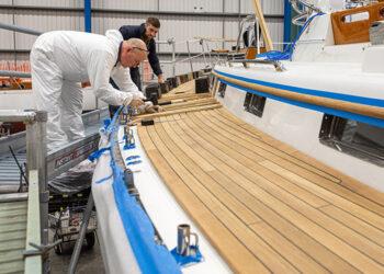 Fitting a new teak deck onboard a yacht