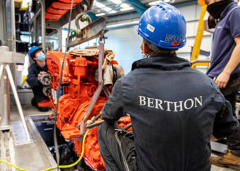 Fitting a newly serviced engine on a commercial vessel